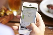 A user requests a ride through Uber's iPhone app