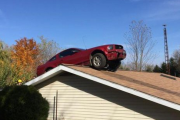 Mustang Driver Loses Control, Lands On Roof Of Michigan Home
