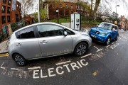 Go Ultra Low Electric Vehicle on charge on a London street