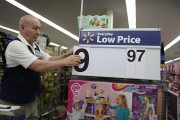 Wal-Mart Prepares For Black Friday Shopping Rush Credit: Joe Raedle / Staff Editorial #: 498622666 Collection: Getty Images News MIAMI, FL - NOVEMBER 24: Jesus Gutierrez puts a low price dollar sign together at a Walmart store as they prepare for Black Fr