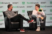 Moderator Darrell Etherington and CEO of Comma.ai George 'Geohot' Hotz speak onstage during TechCrunch Disrupt SF 2016