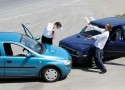Traffic accident - one driver on the mobile phone second expressing anger