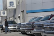 General Motors A man walks past a row of General Motors vehicles at a Chevrolet dealership on Woodward Avenue in Detroit, Mich., on April 1, 2014.